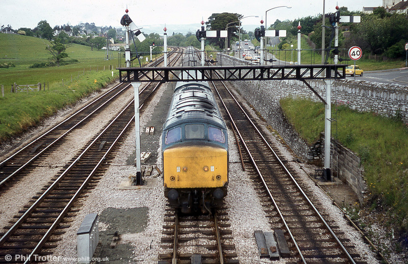 A class 46 passes beneath the signal gantry at Aller Junction, 1979.