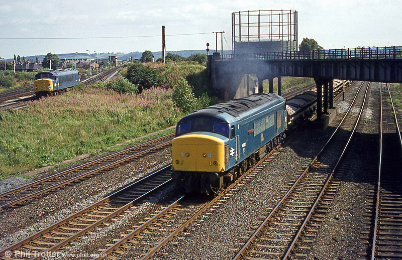 45022 'Lytham St. Annes' heads a ballast train through Toton on 20th August 1980, while 44007 'Ingleborough' lurks in the background. In 1969, 45022 had the distinction of hauling the last scheduled train, 1M82, 2156 Edinburgh to London St. Pancras over the 'Waverley' route. 45022 ended its days at MC Metals, Glasgow and was broken up during October 1991.