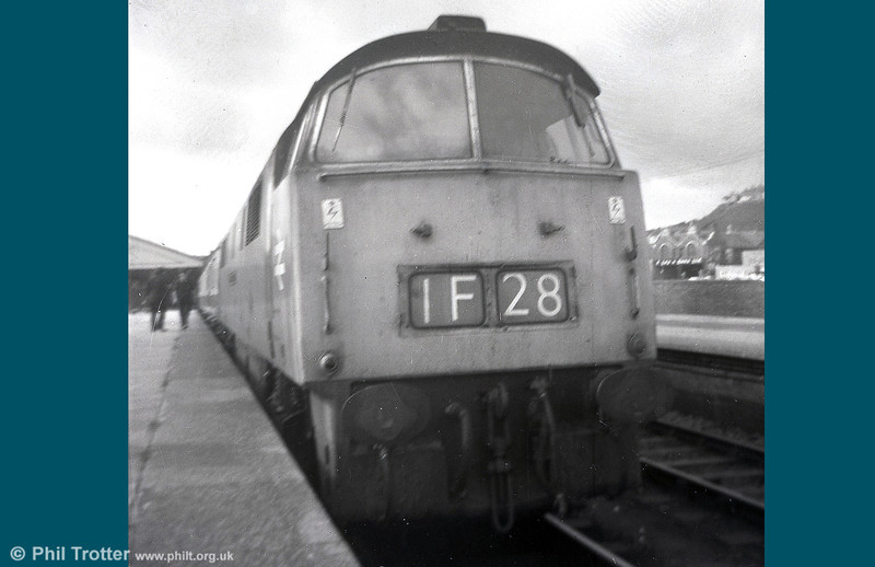 An unidentified class 52 'Western' prepares to set sail from Swansea with a train for London Paddington during the early 'seventies. The loco is still showing the headcode from an inward working.