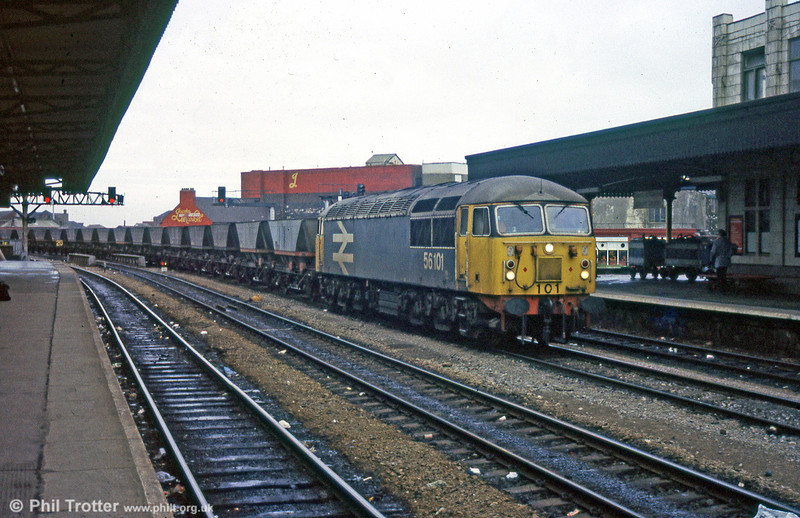 Large logo liveried (and nowadays preserved) 56101 passes through a gloomy Cardiff Central with an mgr train in January 1988.