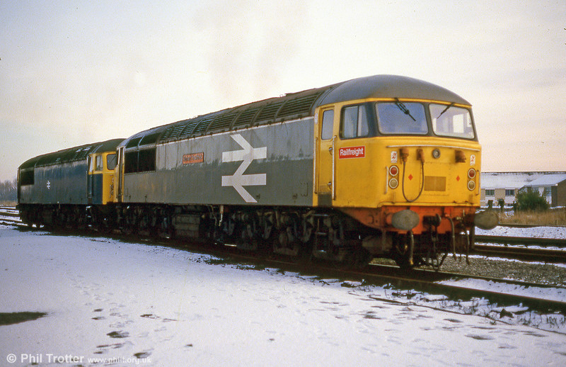 56037 'Richard Trevithick' and a companion ticking over in the snow at Llanelli in February 1986.
