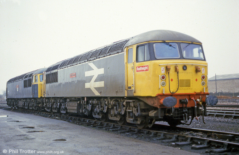 A pair of class 56s stabled at Llanelli on 18th January 1986. 56038 'Western Mail' is in blue, with 56035 'Taff Merthyr' nearest the camera. The latter was named at Taff Merthyr Colliery on 9th November 1981 by Sir Derek Ezra.