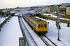 A wintry scene with a Metro Cammell dmu leaving Llanelli in February 1986.