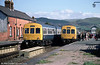 A busy scene with two Metro-Cammell class 101 units crossing at Tywyn in May, 1985.