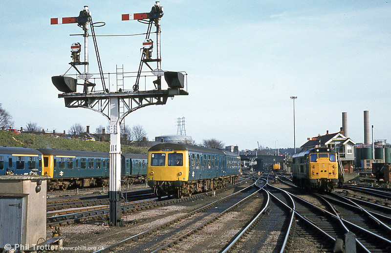 A class 105 and semaphore signals at Norwich on 28th March 1981.