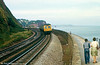 A class 120 on the sea wall at Teignmouth on 24th August 1979.