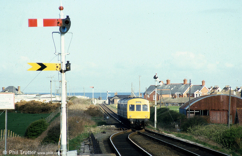 The sea forms a backdrop to this class 101 approaching Tywyn in May 1985.