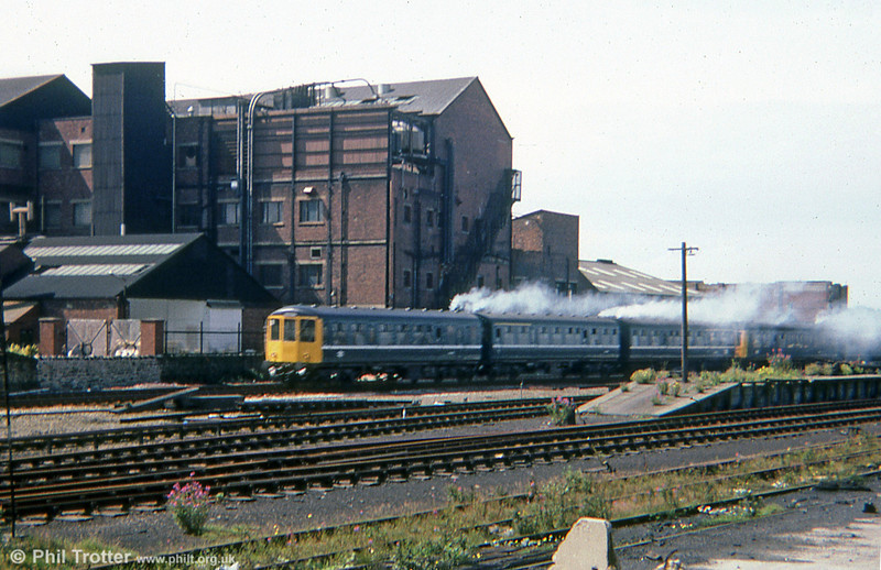 A white stripe liveried class 104 unit leaves a smoke trail as it leaves Southport in 1979.