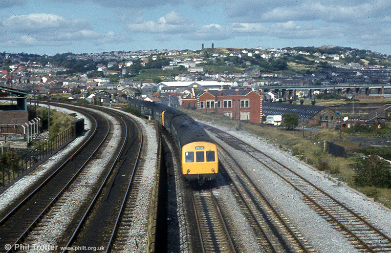 Two 3-car class 101s leave Swansea with a summer relief during the 1980s.
