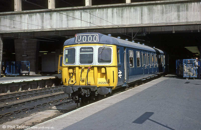 312201 on a stopping service for Wolverhampton at Birmingham New Street on 17th July, 1979.