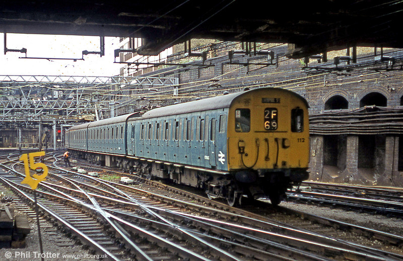 Class 302 unit 112 arriving at London Liverpool Street on 5th August 1980.