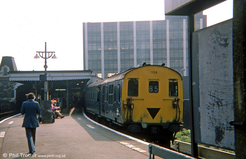 Class 205 Berkshire demu no. 1128 at Portsmouth & Southsea with a service from Romsey to Portsmouth Harbour on 1st September 1975.