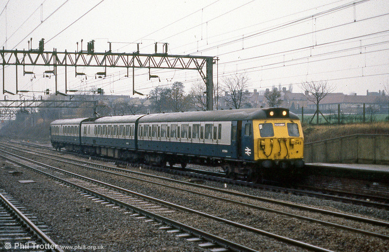 Class 304 emu 304042 calls at Tamworth Low Level with a stopping service for Nuneaton. Following refurbishment in the early 1980s, the class 304 units were reduced to three car formation by removal of the Trailer Composite vehicles and repainted into blue and grey livery.