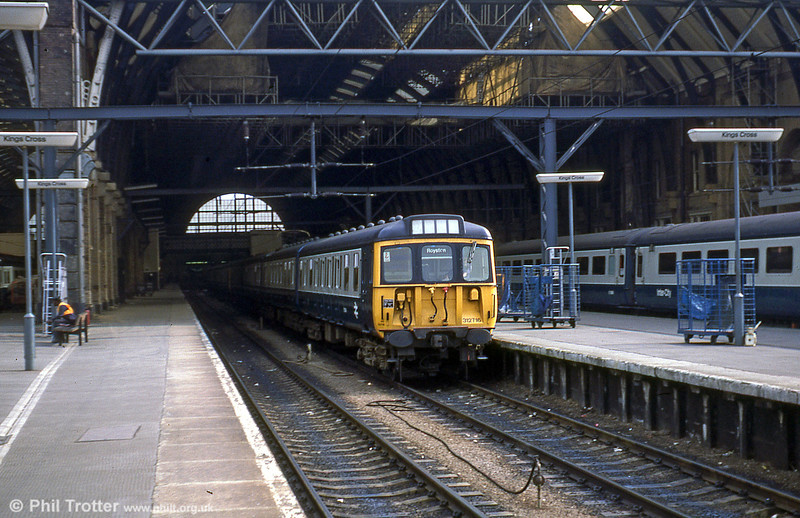 ER class 312 no. 716 at Kings Cross with a service for Royston on 18th July 1979.