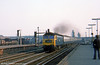 A class 47 speeds through Eastleigh with a cross country service on the evening of 29th August 1975. Loco unknown.