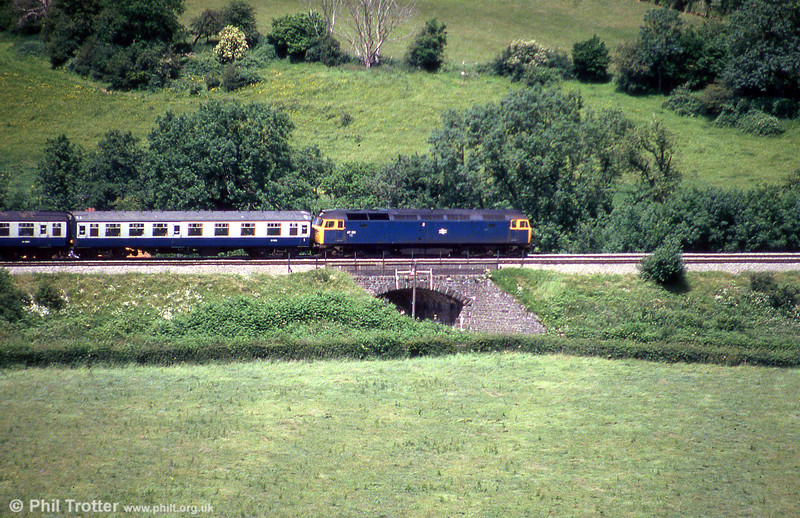 A class 47 heads north on the North and West route at Llanfihangel on 20th July 1985. Loco unknown.