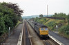 Work on the £40M project to redouble the six miles of line between Llandeilo Junction and Cockett, which includes the replacement of Loughor Viaduct, has recently been completed. Here's a flashback to 2nd August 1980 with 47091 heading through Gowerton in the direction of Swansea. As D1677 this locomotive once carried the name 'Thor' and more recently formed the basis for Virgin 'Thunderbird' 57308 'Tin Tin'. Other points to note in this photograph are the abutments of the bridge which once carried the Swansea Victoria to Pontarddulais section of the Central Wales Line (near the centre of the train) and evidence that the platforms had recently been resurfaced; 1980 was the year in which the National Eisteddfod was held in Gowerton.
