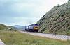 A class 47 passing Langstone Rock, Dawlish Warren c.1981. Loco unknown.