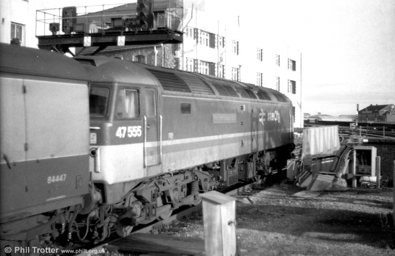 47555 'The Commonwealth Spirit' departs from Cardiff Central on 27th December 1988.