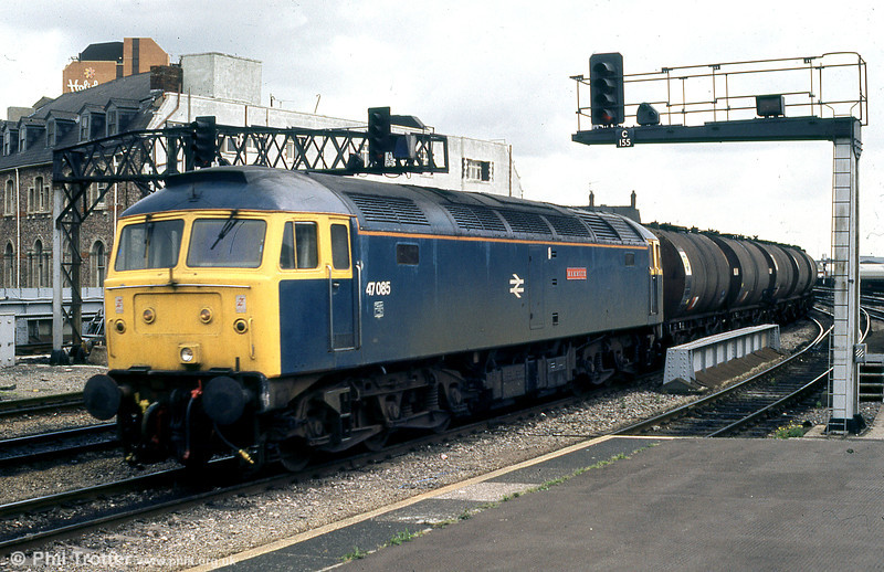 47085 'Mammoth' passes through Cardiff Central with westbound bitumen tanks in June 1988.