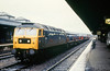 47076 'City of Truro' passes through Cardiff Central with a steel train originating at Margam on 28th October 1981.