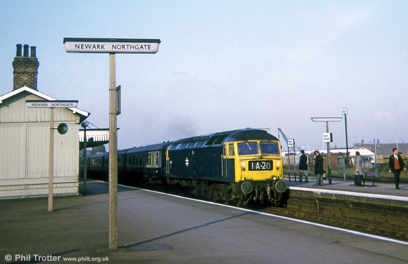 1A20, the 1130 Leeds to London Kings Cross calls at Newark Northgate headed by 47404  on 16th November 1974.