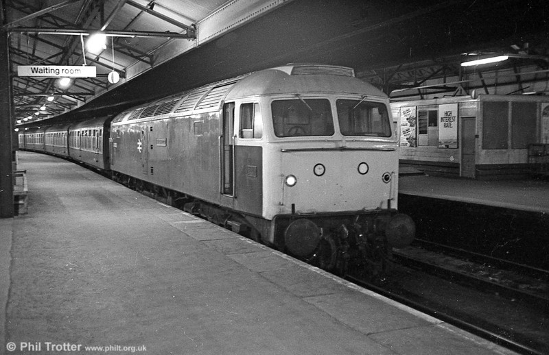 47085 'Mammoth' - then a Stratford engine, with characteristic grey roof - at the head of a return excursion from Norwich on 28 March 1981. The location is Swansea High Street in the days when BR ran some lengthy 'Merrymaker' weekend excursions. This was a return to Swansea for this locomotive which was once allocated to Landore; as D1670 it entered service on March 20th 1965 and so was just over 16 years old when photographed. The loco was withdrawn from Bescot in 1999 and cut up at Wigan.