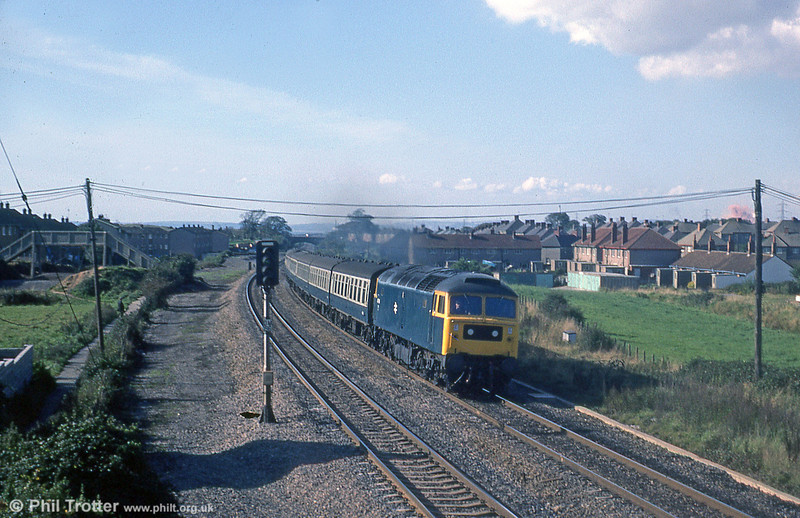 47146 passes Pyle on 5th October 1979. Note the footbridge over the former Porthcawl branch (left) and the cloud of red dust over Margam steelworks on the skyline (right).