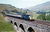 A class 47 crosses Ais Gill Viaduct on the Settle & Carlisle line on 26th August 1981. Loco unknown.