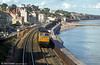 A mixed freight passes Dawlish. Loco unknown.