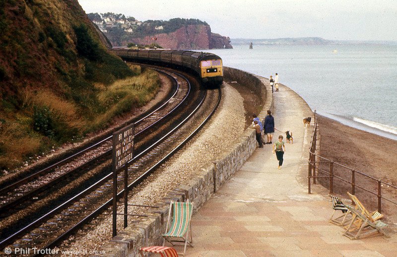 47020 on the sea wall at Teignmouth on 24th August 1979. Note the large BR warning sign.