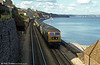 An unidentified class 47 and a flat calm sea at Dawlish.