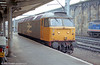 An unidentified class 47/3 in large logo grey livery runs light through Carlisle in September 1990. Loco unknown.