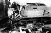 The remains of D1671 'Thor' awaiting scrapping at R. S. Hayes, Bridgend in 1966. The loco had been involved in a collision at Bridgend on 17th December 1965, while working the 0400 Carmarthen to Bristol ECS. The loco, then having only seen 9 months service, was the second of the class to be withdrawn. The nameplates were subsequently applied to D1677 (47091/47647/47846/57308).