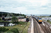 A class 47 passes the camping coaches at Dawlish Warren. Loco unknown.