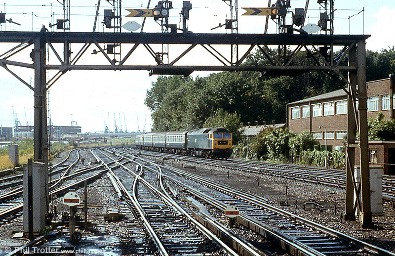 Class 47 framed by the gantry on a wet day at Southampton Central. Loco unknown.