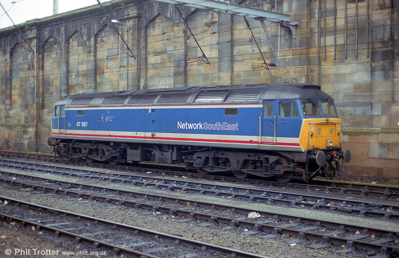 47587, without its 'Cambridge Traction & Rolling Stock Depot' nameplates in Network South East livery at Carlisle in September 1990.