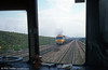 A view from the rear cab of a 'heritage' dmu, with passing HST near Pilning on 19th April 1981.