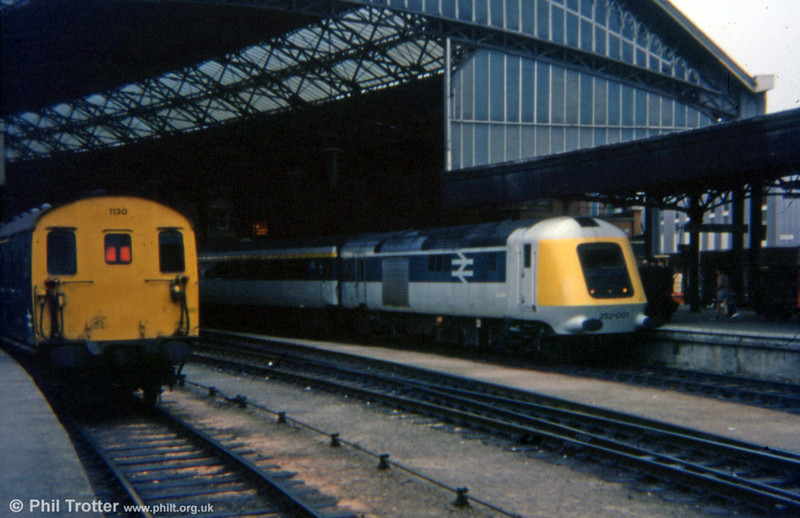 Prototype HST 252001 waits to leave Bristol Temple Meads on 2nd September 1975. The two prototype power cars were originally classed as class 41, nos 41001 and 41002 - later renumbered 43000 and 43001. Alongside is class 205 demu no. 1130 working a Portsmouth to Weston-super-Mare service.