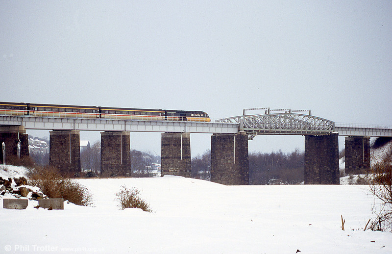 A wintry scene as a Swansea to London Paddington service crosses Landore Viaduct. The foreground is now the site of Swansea's Liberty Stadium.