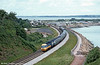 A westbound HST set passes Langstone Rock, Dawlish Warren during the early 1980s.