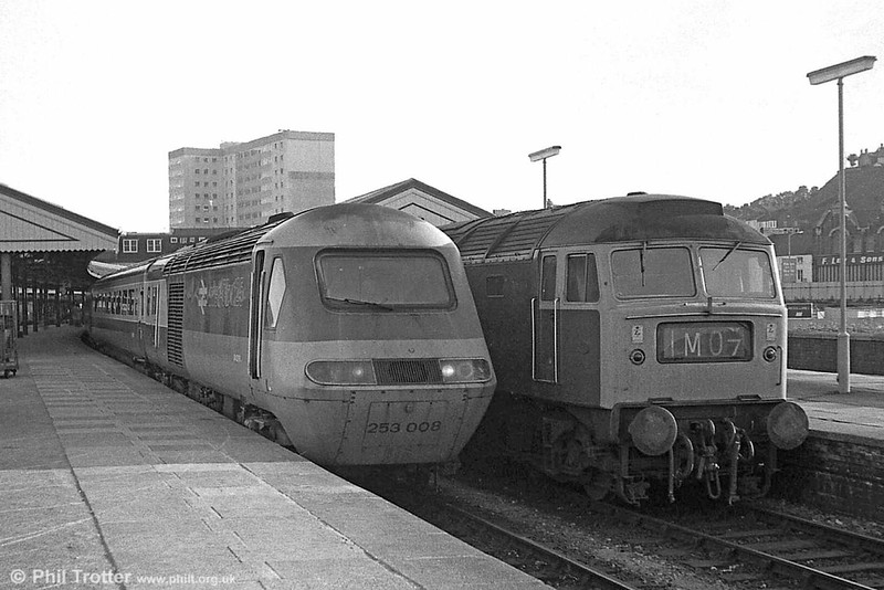 253008 and a class 47 await departure from Swansea.
