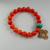 0-RM56-OTQ CO38  BRIGHT ORANGE BEADS WITH ONE TURQUOISE AND 5 WAY CROSS