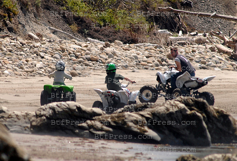 BRAD PITT - ANGELINA JOLIE ENTERTAIN GWEN STEFANI AND GAVIN ROSSDALE AT THEIR SANTA BARBARA BEACH-SIDE RETREAT. BRAD TOOK MADDOX OUT FOR 4WHEELER LESSONS IN THE SAND - STOPPING JUST OUT OF ANGELINA'S VIEW TO SHOW OFF HIS STUNT MAN SKILLS TO MADDOX - WHILST WEARING NO HELMET OR SAFTEY GEAR - GAVIN JOINED THE CREW LATER, CONSERVATIVELY RIDING AN OLDER AND MORE STABLE MACHINE - ANGIE SAT UNDER A PALM TREE WITH ZAHARA AND SHILOH - WHILST GWEN WANDERED THE GROUNDS CARRYING HER NEWBORN. ALL IN ALL THE TWO FAMILIES SEEMED TO BE HAVING A GREAT 4TH OF JULY HOLIDAY IN THE CALIFORNIA SUNSHINE.