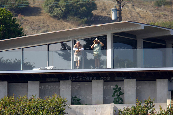 Malibu,California. Brad Pitt's bodyguards- Brad Pitt has decided to sell one of hisÊhouses. HeÕs putÊhisÊMalibu estate on the market Ñ the asking price?ÊOnly $18 million, almost $12 million more than he paid for it in 2005.ÊThe glass-walled contemporary mansion is perched on a bluff overlooking the ocean andÊhas a large swimming pool andÊtennis court. ÊPitt still has an oceanfront Ênorth of Santa Barbara, aÊlongtime home the Los Feliz neighborhood of Los Angeles, another home with current partner Angelina JolieÊin New OrleansÊand a 40+ acre estate in Lloyd Neck, New York. They also lease the Chateau Miraval estate in rural France.