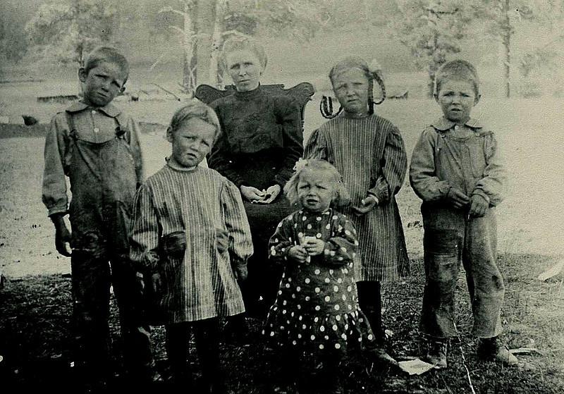 Jake Bramwell family early, total 11 children:  (left to right) Ed, Lois, Hattie/mother, Margaret, Byrel, Carl. early 1900's. Pagosa Springs.  Near a logging camp.