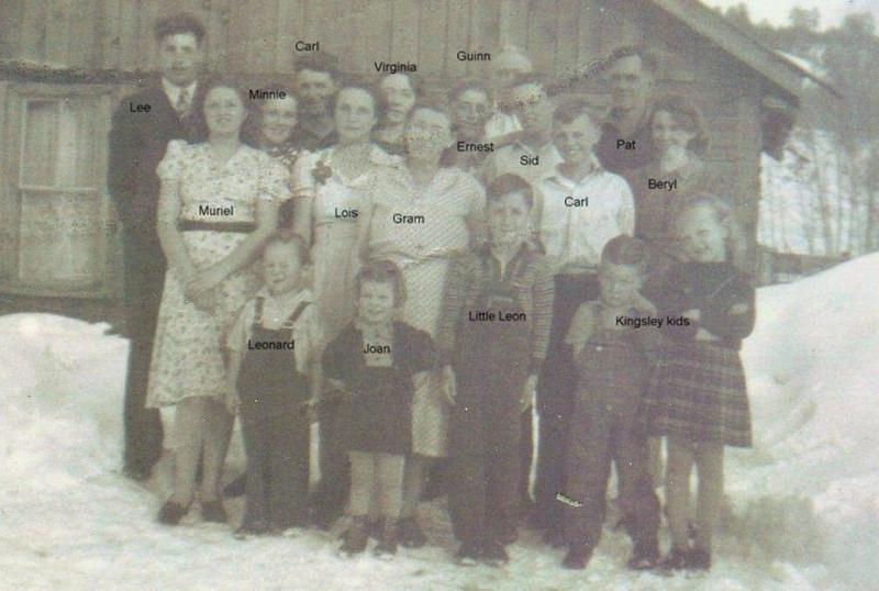 Adults left to right: Lee Turner, Muriel Bramwell, Minnie Castle-Bramwell, Carl Bramwell, Lois Bramwell-Kinser, Virginia Amyx-Bramwell, Gram/Hattie Fisk-Bramwell, Ernest Bramwell, Guinn Kinser, Sid Dutton, Carl Dutton, Pat Dutton, Beryl Bramwell-Dutton. Children in front - left to right: Leonard Kinser, Joan Turner, Little Lynn Bramwell, two Kinsley kids raised by Beryl. (Photo owned by Opel Bramwell-Turner, taken by Opel Bramwell-Turner. Family members identified by Opel Bramwell-Turner & Beverly Turner-Leas.)