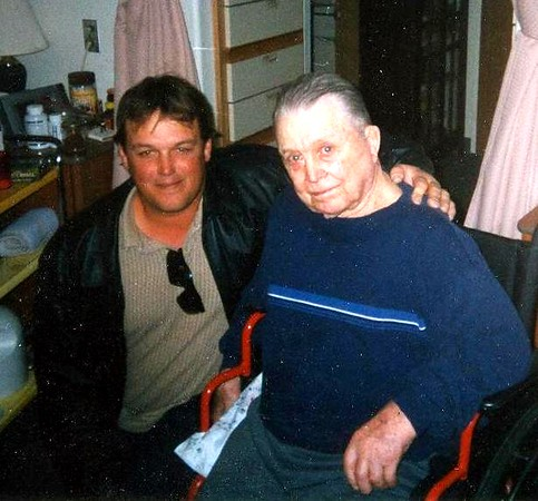 Carla's oldest son, Travis with his Uncle Floyd Dec 2002.