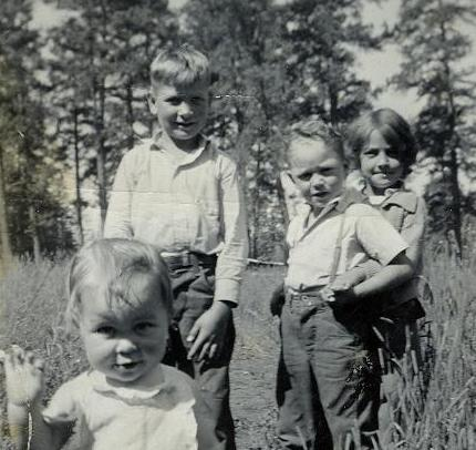 Connie with cousins, Les Davis, Leonard Kinser, and Betty Lou Davis.  All the kids were staying with Mom and Dad and really got a kick out of Connie! They were living in the Blanco Basin.