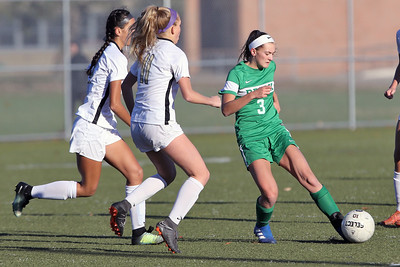 Reese Beggs (right) from Brick battle with Hopewell Valley defenders as Brick Township High School hosted Hopewell Valley High School in the NJSIAA Central Jersey Group III Girls Soccer Championship at the Drum Point Sports Complex in Brick Township on Saturday November 10, 2018. (MARK R. SULLIVAN/THE OCEAN STAR)